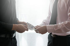 Two business man dealing. Two business men dealing with handing money Stock Image