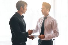 Two business man dealing. Two business men dealing with handing money Stock Photos