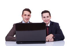 Two business men at a desk Royalty Free Stock Photo
