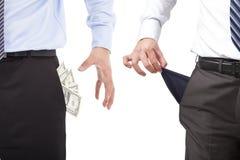 Two Business men grabbing  pocket money. Over white in studio Royalty Free Stock Photos