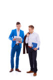 Two business men holding contract folder isolated on white Royalty Free Stock Photo