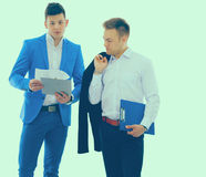 Two business men holding contract folder isolated on white.  Stock Photo