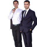 Two business men holding contract folder isolated on white background.  Royalty Free Stock Photos