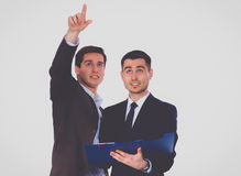 Two business men holding contract folder isolated on white background.  Royalty Free Stock Photo