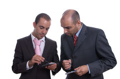 Two business men holding PDA. Showing business results Stock Image