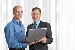 Two business men with laptop Royalty Free Stock Image