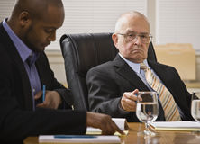 Two business men meeting. One African American, one white senior male. Horizontal Royalty Free Stock Image