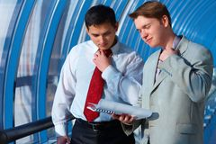 Two business men in problems Stock Photography