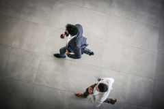 Two business men running trough business build. Business men running to meeting. Space for copy Royalty Free Stock Photo
