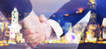 Two business men shaking hand on blurry background Stock Photo