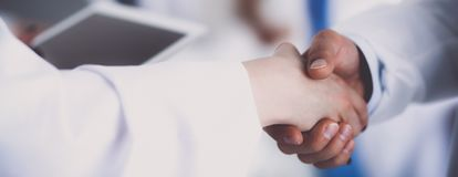 Two business men shaking hands.  Stock Photos