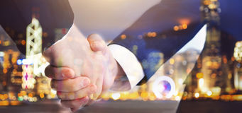 Two business men shaking hands on blurry background Stock Image