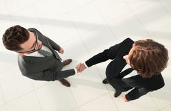Two business men shaking hands  in the office Royalty Free Stock Images