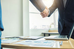 Two business men shaking hands during a meeting to sign agreemen. T and become a business partner, enterprises, companies, confident, success dealing, contract Stock Images
