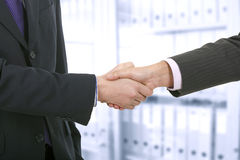 Two business men shaking hands. In the office Royalty Free Stock Photos