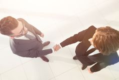 Two business men shaking hands  in the office. Two business men shaking hands during a meeting in the office Royalty Free Stock Photography