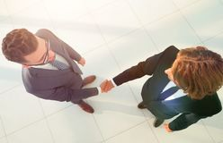 Two business men shaking hands  in the office. Two business men shaking hands during a meeting in the office Royalty Free Stock Images