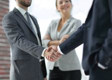 Two Business men shaking hands. While team smiling at office Royalty Free Stock Image