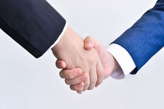 Two business men shaking hands Stock Images