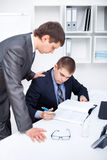 Two business men signing papers Royalty Free Stock Images