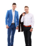 Two business men standing isolated on white background.  Stock Photo