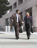 Two Business Men Walking On City Street stock images
