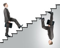 Two business men walking up stairs. Two business man walking up stairs in different sides Stock Images