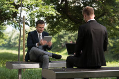 Two Business Men Working On A Computer Royalty Free Stock Photo