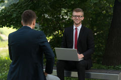 Two Business Men Working On A Computer Stock Photography