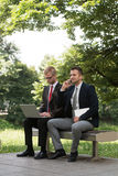 Two Business Men Working On A Computer Royalty Free Stock Photos