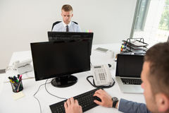 Two Business Men Working On A Computer Stock Photo