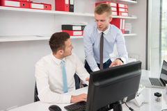 Two Business Men Working On A Computer Royalty Free Stock Images