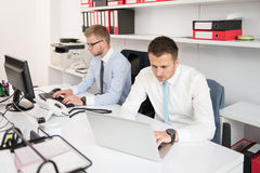 Two Business Men Working On A Computer Royalty Free Stock Image