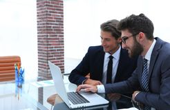 Two business men working on a laptop. Photo with copy space Stock Photo