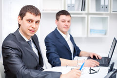 Two business men working together Stock Image
