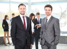 Two business men working together. In the office Stock Photos