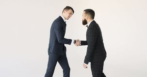 Two business partner shake hands when meeting. Handshake: two businessmen shaking hands stock video
