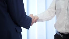 Two business partner shake hands when meeting. In slow motion stock footage