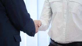 Two business partner shake hands when meeting. In slow motion stock video