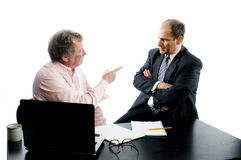 Two business partners at desk disagreement Royalty Free Stock Photo