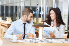 Two business partners discussing diagram report. During coffee break Royalty Free Stock Photo