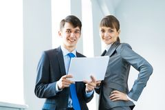 Two business partners discussing reports Royalty Free Stock Images