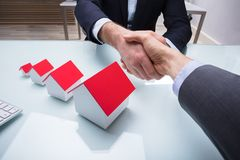 Two Business Partners Shaking Hand At Workplace stock photography