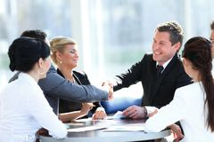 Two business partners shaking hands on meeting Stock Image