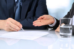 Two business partners signing a document Stock Photo