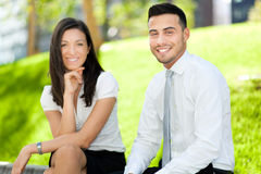 Two business partners sitting outdoor Royalty Free Stock Photo