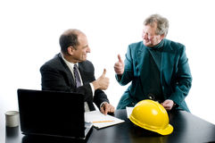 Two business partners successful deal. Business management senior executives client  with positive sign thumbs up in office retired older men architect builder Stock Photos