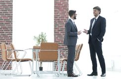 Two business executives talking about business in the office. Two business partners talking about business in the office stock photo