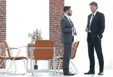 Two business executives talking about business in the office. Two business partners talking about business in the office royalty free stock photos