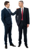 Two business partners talking together Royalty Free Stock Image